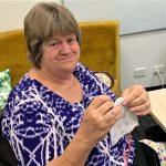 STEPS Volunteer Kerri Roberts sews
