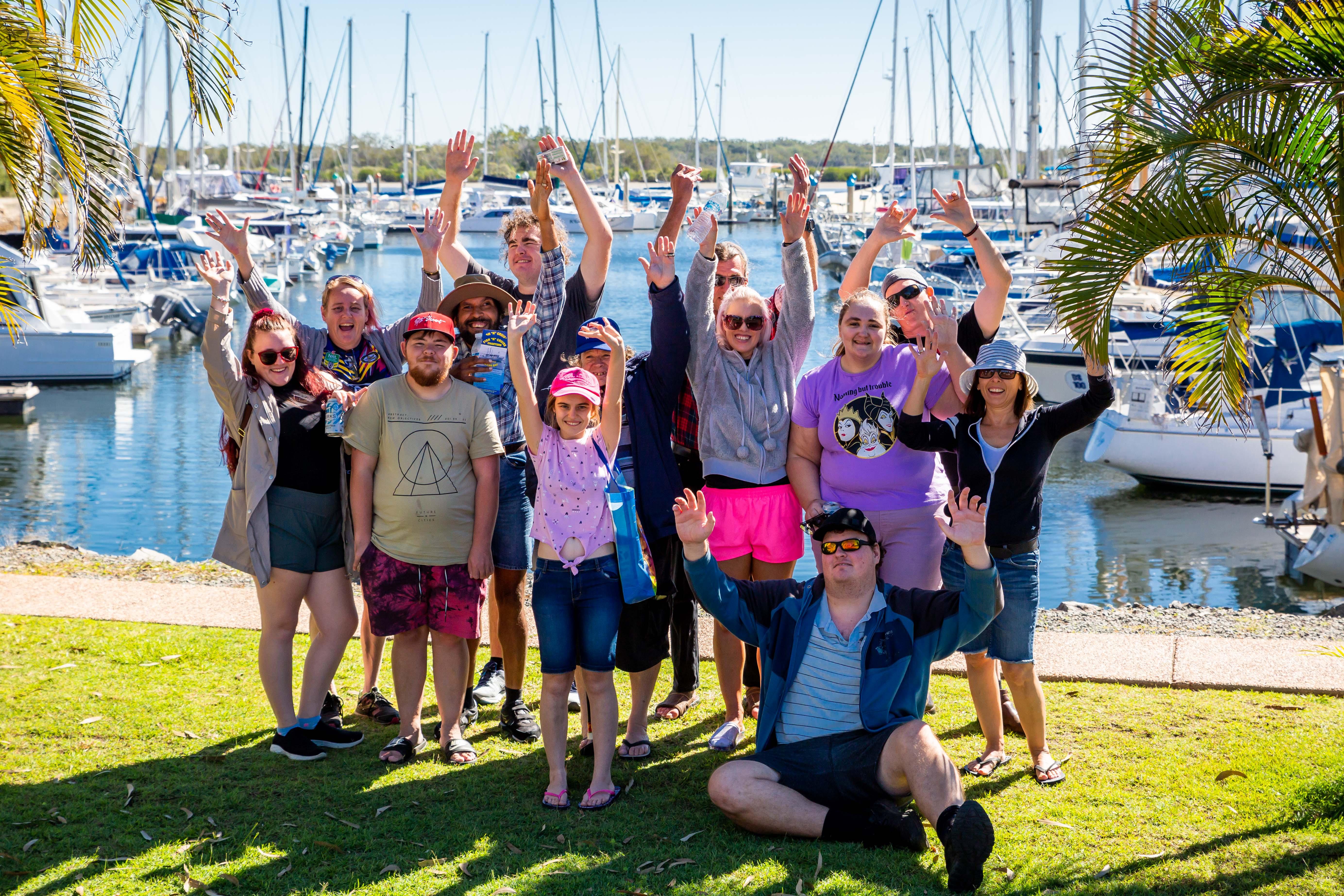 Group of happy people near a marina