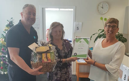 Staff honouring support worker
